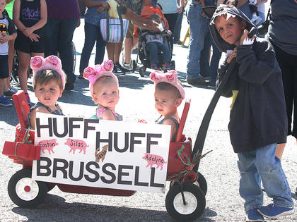 Jackson Brussell, dressed as a wolf, and the three little pigs, from left, Silas Huff, Adelyne Huff and Easton Huff, won best group in the children's parade.