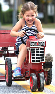 Lillian Lowrey, 4, of Leitchfield competes in the pedal pull competition.
