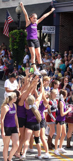 Gymnasts from Fit Kids perform during the PIGasus Parade.