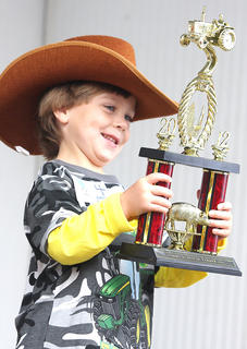 Keegan McKay Cheser, son of Joey and Millie Cheser, won the Tommy Burress Jr. Farmer contest Saturday morning during the 2012 Marion County Country Ham Days.