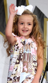 Kinzlee Rhiana Ford, daughter of Krissie and David Ford, does her best pageant wave during the Little Miss Ham Days competition.