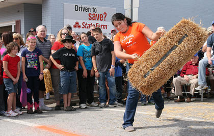 Mary Bradshaw of Lebanon gives it everything she has in the hay bale toss.