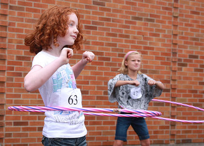 MacKenzie Satterly, left, and Maddison Leake were in the swing of things in the hula-hoop contest Saturday morning at St. Augustine.