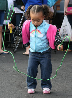 Kayleeona Furmon, 2, tries to figure out how to jump rope.