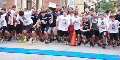 Runners take off at the start of the Farmers National Bank Pokey Pig 5K.