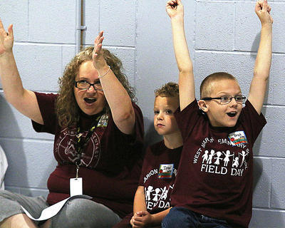 The annual Special Kids Special Talents Field Day was held at Lebanon Elementary School Thursday, Oct. 1. From left, West Marion Elementary School's Angie Skaggs, Israel Medley and Brock Hargis get pumped up for Special Kids Special Talents Field Day.