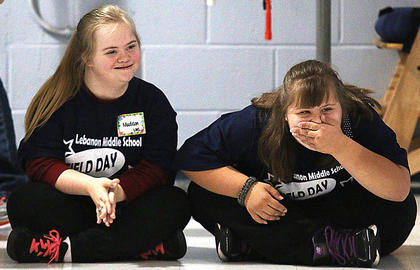 Lebanon Middle School students Madison Barlow, left, and Kayla Garrett laugh during one of the relay events.
