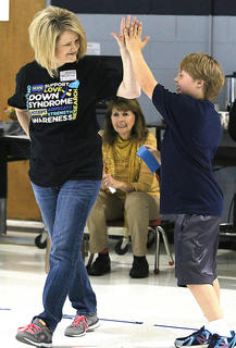 Michelle Vittitow high fives her son Patrick Vittitow, a student at Lebanon Elementary School.