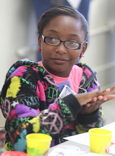 Imani Biggers rolls play-doh during a children's art class hosted by the monks Oct. 8 at the Marion County Heritage Center.
