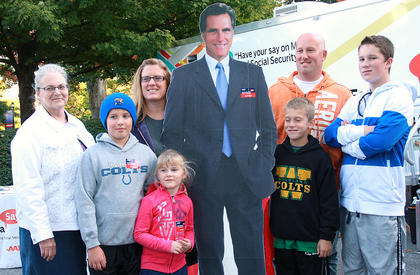 The Samons family shows their support by posing with a Mitt Romney cutout.