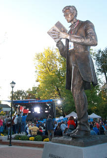 A statue of Abraham Lincoln, adorned with a media credential, looms over the MSNBC open air studio.