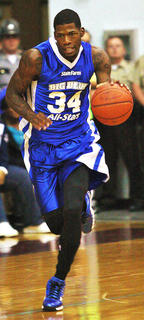 DeAndre Liggins dribbles the ball down the court against Saint Catharine College in the Big Blue All-Stars game.