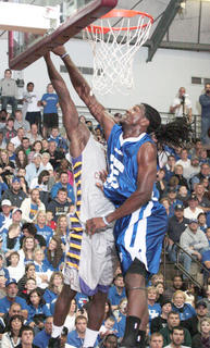 Faried blocks another shot.