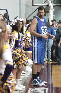 Josh Harrellson of the New York Knicks chats with a St. Catharine cheerleader while waiting to inbound the ball.