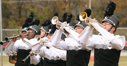 From left, Labriette Owens, Andrea Ackermann, Zach Terrell, and Zach Brady of the Marion County Marching Knights perform in the AAAA state semifinals Oct. 27 at Barren County High School.