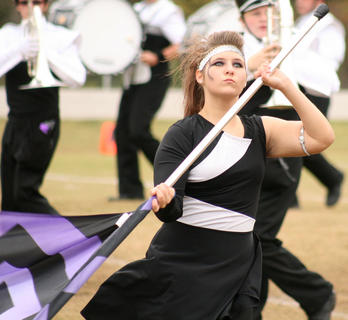Katie Elmore spins and twirls a flag.