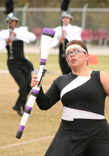 Karly Baize spins a rifle during the state semifinals.