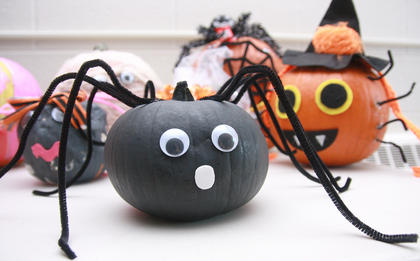 This pumpkin is the body of a cute little spider.