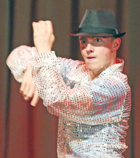 """Bobby Wilson performs """"Bop to the Top"""" from High School Musical during the talent portion of the competition."""