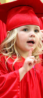 Madelyn Shannon, 3, performs during the preschool graduation ceremony.