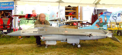 Bill Marshall of Decatur, Ill., poses with a scale model F16.
