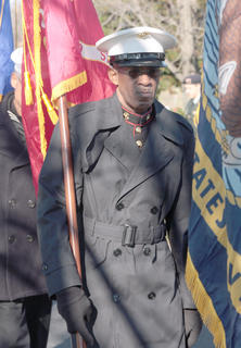 David Thompson of the Marion County Veterans Honor Guard carries a flag for the Marines.