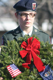 Marcia Gaines of the Marion County JROTC carries a ceremonial wreath in honor of the Merchant Marines.