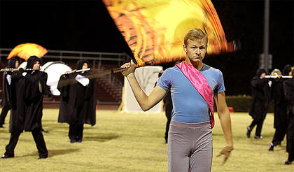 Matthew Huff performs with the color guard.