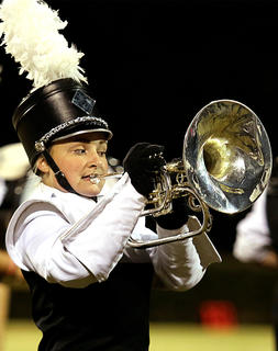 Paige Gaddie watches her steps while performing with the band.