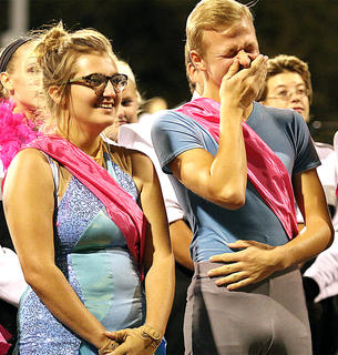 Matthew Huff gets tickled during some of the comments made about the seniors before the band's performance Thursday evening. Pictured beside Huff is Kennedy Mayo.