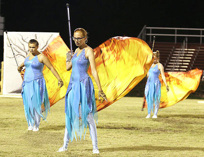 Kenna Luckett and Autumn Gaines perform with the color guard.