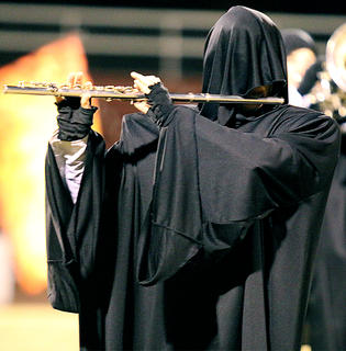 Lauran Knott plays her flute in disguise during the band's performance Thursday.