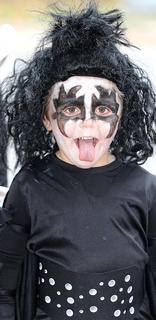 Silas Huff and his brothers dressed up as members of the band KISS.