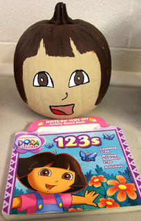This pumpkin looks like it could come alive as Dora the Explorer.