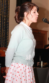 Sherry Howard sings during the musical performance before the live auction.