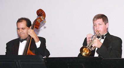 Saulo de Almeida, left, and Reece Land provided musical accompaniment to the singers.