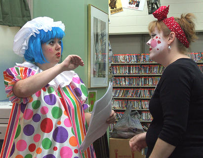 Children's adult librarian Patty May Brown, left, and library director Amy Morgeson are speaking more seriously than their costumes may suggest.