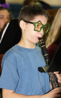 Collin Allen wears some crazy glasses as he plays his clarinet.