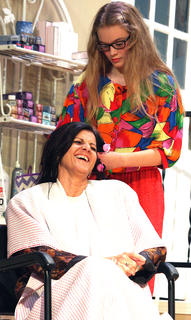 M'Lynn, mother of the bride, laughs with the girls in Truvy's shop as a nervous Annelle does her hair for the wedding ceremony.