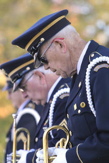 America Legion Post 49 hosted the annual Veterans Day program at Lebanon National Cemetery on Sunday afternoon. The ceremony honored military veterans past and present from Marion County. Pictured is Frank Spragens and Joe Taylor bowing their heads in prayer while in formation.