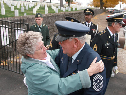 Shirley Bland hugs Paul Powell prior to the start of Sunday's Veterans Day program.