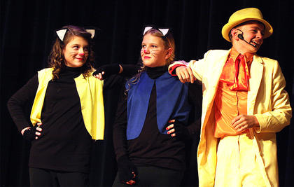 From left, alley cats Lauren O'Bryan and Alaina Brockman hang out with the friendly alley cat Thomas O'Malley, played by Bobby Wilson.
