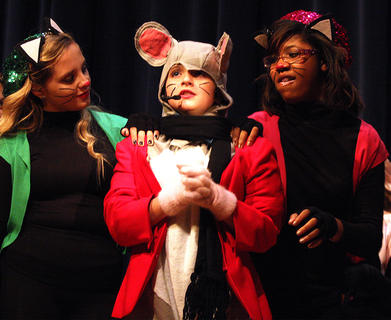 Savannah Chapman, center, playing the part of Roquefort, a friendly mouse who tries to save the cats, becomes frightened as she is surrounded by hungry alley cats Brittany Murphy, left, and Alaysia White.