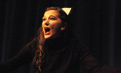 Alley cat Presley Wilson sings during the opening number.