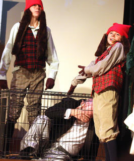 After the cats are freed, the dogs help put Edgar in the cage. Pictured with Edgar, played by Lynn Farris, are Jaxon Wheatley, left, and Abbey Hickey.