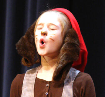 Elana Chesser shows off her howling abilities as one of the dogs in the musical.
