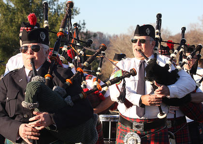 Bagpipers escort the hearse as it arrives at the Old Liberty Cemetery.