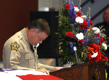 Marion County Sheriff Jimmy Clements takes a moment to collect himself before speaking at Deputy Rakes' funeral.