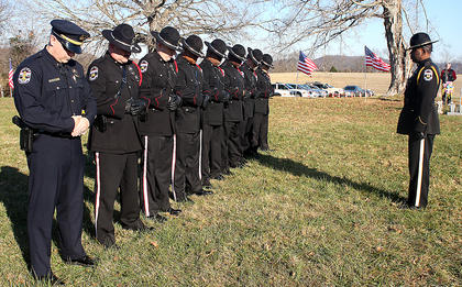 Louisville Honor Guard members practice their formations before the graveside service.