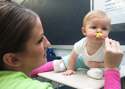 Davette Mays offers her niece, Kaylen Bartley, a piece of pineapple.